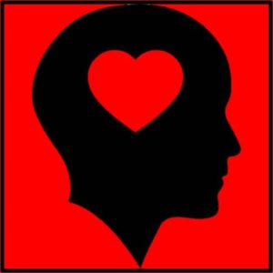 Silhouette of head with heart in it.